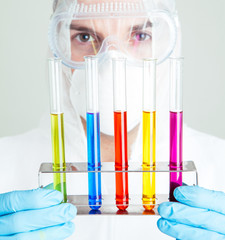 Close up of scientist holding rack of test tubes