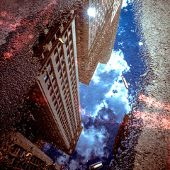 USA, new York State, New York City, Skyscraper reflecting in puddle