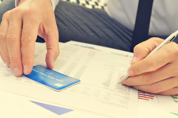 young man checking the information of his credit card
