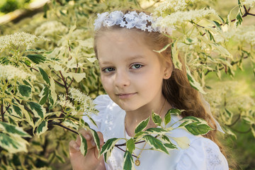 First communion girl (8-9) between leafs