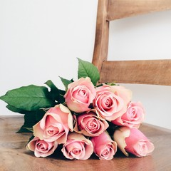 Pink roses lying on chair