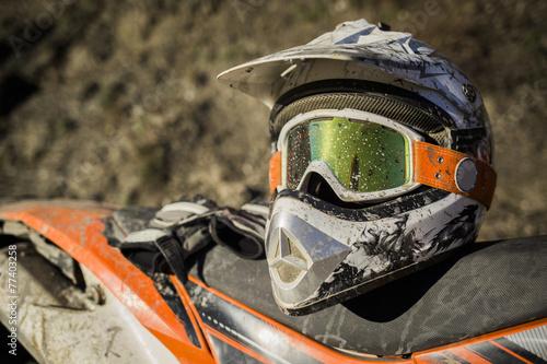 Leinwanddruck Bild Dirty motorcycle motocross helmet with goggles