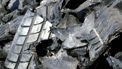 shredded car tires pile for recycling. tilt.