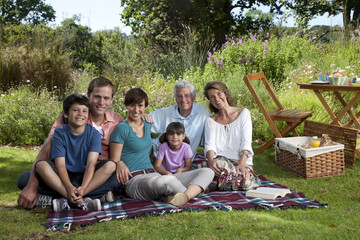Three generation family portrait in park