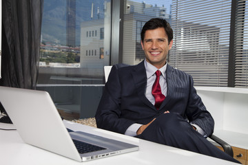 Businessman sitting at desk in office