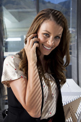 Businesswoman using phone in the office