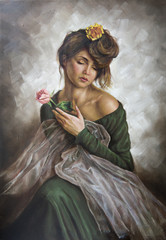 young woman with a flower in her hair and green dress