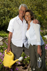 South Africa, Senior couple standing together in the garden