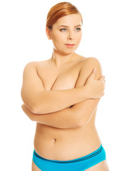 Fat woman covering her breast