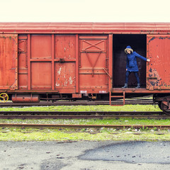 Woman standing in train carriage