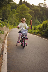 Girl (2-3) riding bicycle