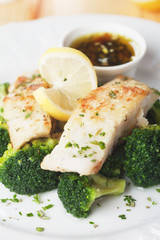 Grilled cod fish steak with broccoli