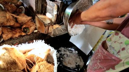 Shredding coconut, Phuket Market, Thailand