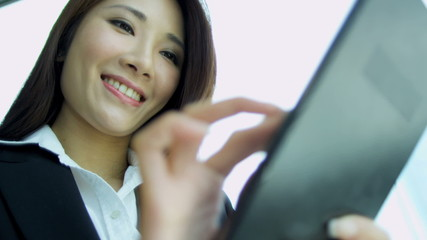 Female Asian Chinese Stock Broker Tablet Close Up