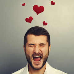 screaming man with red hearts