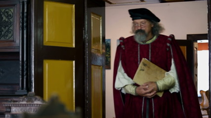 Old 19th century scholar entering the room