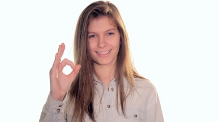 young woman showing okay sign