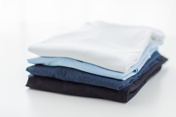 close up of ironed and folded t-shirts on table