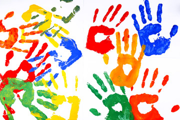 Hand prints of paint on white background