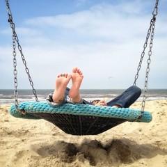 Kids lying in a swing