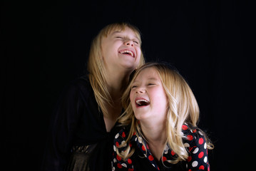 Studio shot of two Sisters (12-13, 16-17) laughing