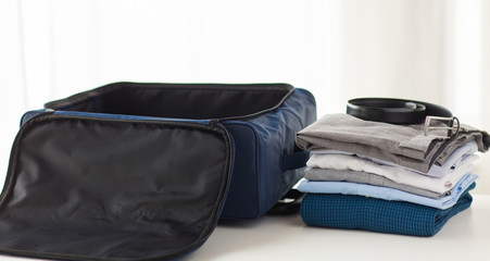 close up of business travel bag and clothes