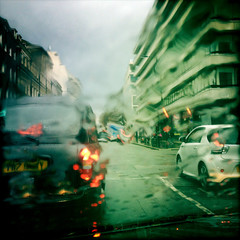 UK, London, Westminster, Knightsbridge, Taxi and car in wet weather