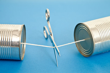 Scissors about the cut string on Tin Can phone