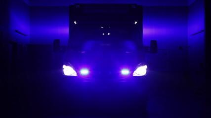 German ambulance truck, sirens and headlight at night.