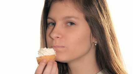 pretty young woman eating chantilly