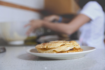Spain, Malaga, View of girl (10-11) cooking pancakes