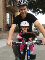 Father and daughter (18-23 months) cycling together