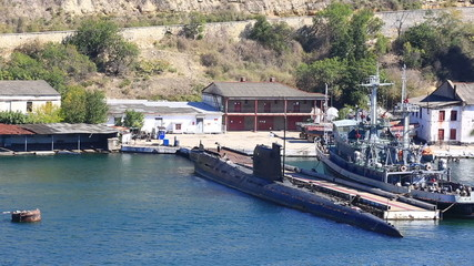 submarine and warship onanchor parking in a bay of Sevastopol