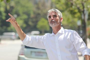 Businessman hailing cab
