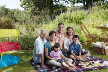 Three generation family in park having picnic