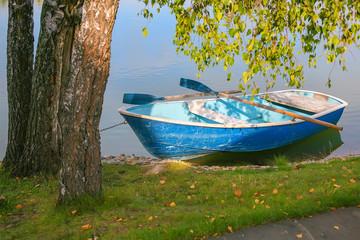 boat with oars near coast