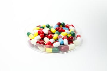 Petri dish full of pills