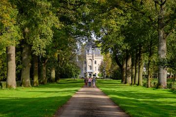 Netherlands, Gelderland, Brummen, Three women walking to castle