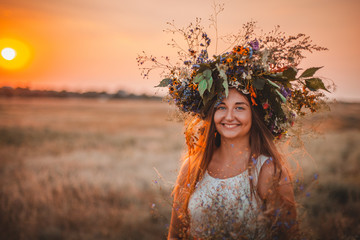 Beautiful young woman with floral diadem on her head