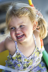 Portrait of girl laughing outdoors