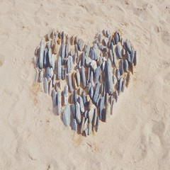 Heart in the sand made with pebbles