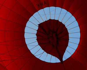 Myanmar, Mandalay, New Bagan, Red hot air balloon from below