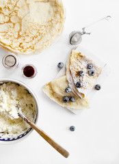 Pancakes with white cheese and blueberries