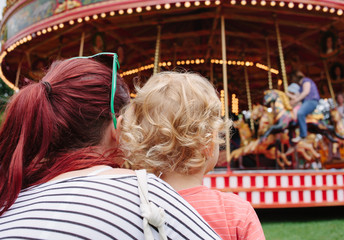 UK, Mother and young son at fairground