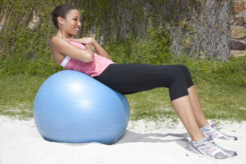 Woman Exercising On Swiss Ball