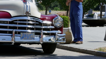 Vintage car drives towards the camera and wobbles
