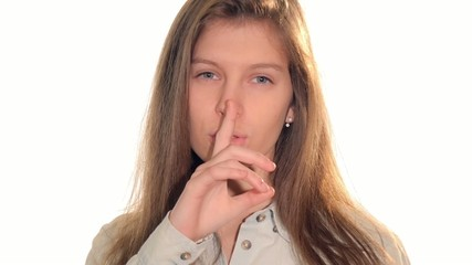 pretty young woman doing a silence sign