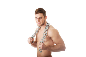 Well build male model with chains over his body.