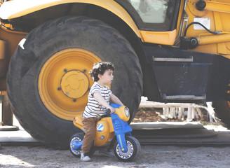 Boy with bike and bulldozer