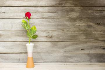 still life rose flower on wood